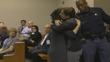 Andrea Sneiderman hugs her friend Shayna Citron after testimony_1261916