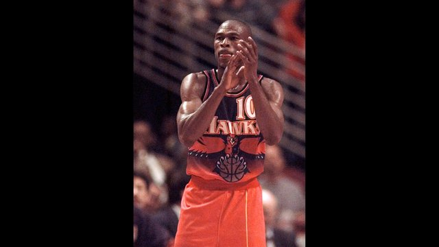 f9e8f985b The Atlanta Hawks  Mookie Blaylock cheers his teammates on during the  fourth quarter of their playoff game with the Chicago Bulls Thursday