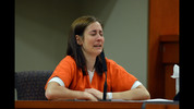 Andrea Sneiderman gives a statement on her behalf during sentencing Tuesday.