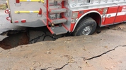 An Atlanta fire truck was damaged after a huge sinkhole opened on Ashby Grove in SW Atlanta.