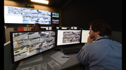 Tech student Jeremy Tallant works remote cameras inside Georgia Tech's safety operations center. KENT D. JOHNSON / KDJOHNSON@AJC.COM