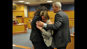 Stacey Kalberman, center, is hugged by her attorney Kimberly Worth, left, and husband Neil after winning a whistle blower lawsuit against the state ethics commission. The former state ethics commission executive director sued after she claimed she was forced from her position after investigating Gov. Nathan Deal's campaign.