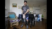 In this March 25, 2014 photo, Boston Marathon bombing survivor Marc Fucarile puts on a prosthetic leg at his home in Reading, Mass. He is adamant that he will recover and return to a full and active life; his focus is on others. He wants to be a motivational speaker and to set up a fund to help those who have suffered similar injuries, no matter the circumstances. He has been inspired by the generosity he has seen over the past year. (AP Photo/Steven Senne)