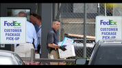 Authorities bring out evidence from the scene of the early morning workplace shooting at a FedEx facility in Kennesaw on Tuesday, April 29, 2014. HYOSUB SHIN / HSHIN@AJC.COM