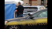 Cobb County Police investigate the SUV where a toddler died Wednesday June 18, 2014 when the father forgot to drop his child off at day care and went to work. BEN GRAY / BGRAY@AJC.COM