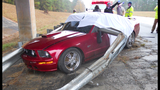 Guardrail Pierces Through Mustang_6337071