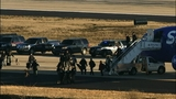 FBI officials investigated a bomb threat to two planes at Hartsfield-Jackson Atlanta International Airport. _6699072