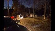 A sheriff's deputy takes notes while investigating the shooting scene where authorities say five people are dead, including the gunman, in Douglasville, Ga. on Saturday, Feb. 7, 2015. Douglas County Sheriff's Lt. Glenn Daniel said the gunman shot six people before fatally shooting himself, and the two surviving victims are children, but children are also among the dead. (AP Photo/David Goldman)