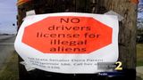 signs against undocumented immigrants with licenses_6968378