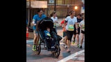 Nurse Gary Harris runs with former CHOA patient Rebecca Holbrook and her mother Marjan Holbrook. _7011550