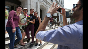 June 26, 2015 Decatur: Kai Gill shoots a photo of the happy couple with friends Hilary Smith, left and Katie Acosta, right, just after their second ceremony on the steps of the Fulton County Courthouse on Friday June 26, 2015. Ben Gray / bgray@ajc.com