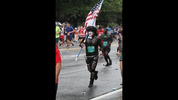 Nothing says America like a guy dressed like KISS, carrying an American flag, running in the annual July 4th event.