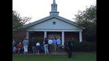 Large crowd assembling outside church former President Jimmy Carter attends in Plains, GA_7991739