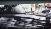 September 25, 2015 Sandy Spring - An overturned Publix tractor-trailer rests on Ga. 400 on Friday, September 25, 2015. Two tractor-trailers plunged off I-285 onto Ga. 400, shutting down the busiest interchange in the state during the Friday afternoon lunch hour and sending three people to the hospital. All northbound lanes of Ga. 400 and some eastbound lanes of I-285 remained closed just before 2 p.m., and the Sandy Springs Police Department predicted the road closures would last through rush hour. HYOSUB SHIN / HSHIN@AJC.COM
