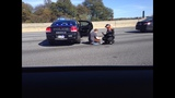 Officer helps mother and child after I-285 accident_8432790
