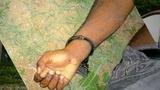 Maurice Hampton's hand with a handcuff_8515725