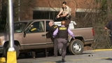 Police surround a murder suspect near the Marietta Square_8540653