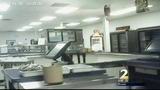 Cafeteria worker accused of possibly stealing $1M arrested