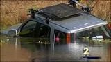 Witnesses describe car crash into pond