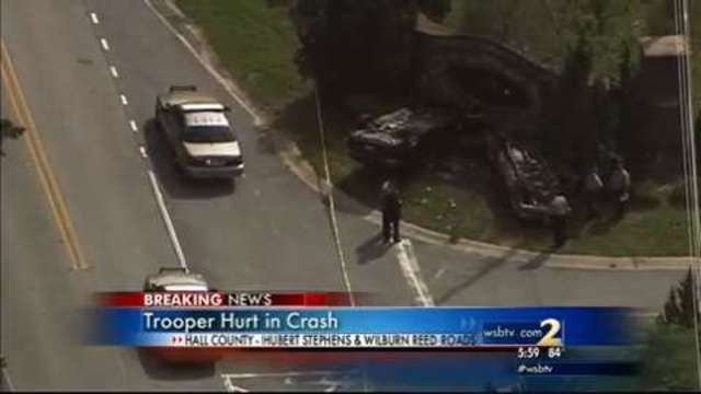 Trooper involved in rollover wreck with another car