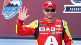Dale Earnhardt Jr. waves to the crowd during driver introductions prior to a NASCAR Sprint Cup Series auto race at Phoenix International Raceway, Sunday, March 13, 2016, in Avondale, Ariz. (AP Photo/Ross D. Franklin)