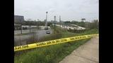 Investigators work to identify woman's body found along I-85
