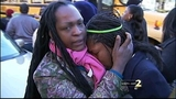 Emotional reunions with parents and children after school shooting