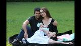 Shahriar Zolfaghari, his wife, Assistant Attorney General Camila Wright, and their young child