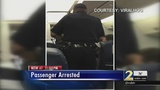 Video shows officers dragging woman off plane at Atlanta airport