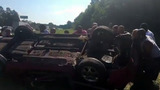 Strangers come to rescue of driver in flipped car