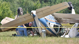 Authorities investigate the site where 3 people were killed after 2 planes collided at West Georgia Airport at Carroll County. The FAA will investigate and the NTSB will determine the cause of the accident. HYOSUB SHIN / HSHIN@AJC.COM