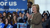 Hillary Clinton steps on stage with Atlanta Mayor Kasim Reed at a campaign event at the Old City Council Chambers in City Hall, Friday, Feb. 26, 2016, in Atlanta. (AP Photo/David Goldman)