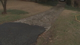 Crumbling driveway could send woman to jail