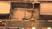 A gap in the overpass of I-85 after a massive fire caused it to collapse.