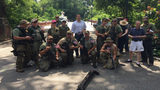 Michael Williams posing with members of the Georgia Security Force III% militia. (Credit: AJC)