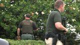 Deputies carrying long guns were waiting for the men outside.