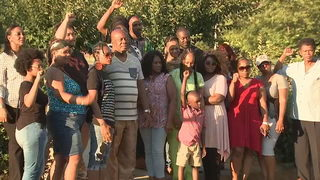 Group rallies in support of man accused of killing former officer