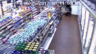 Police hope to find gunman seen dragging employee during robbery