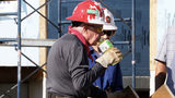In this photo provided by the Manitoba Government, former U.S. President Jimmy Carter drinks while helping build homes for Habitat for Humanity in Winnipeg, Manitoba on Thursday, July 13, 2017. (Stacia Franz/Manitoba Government via AP)