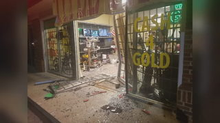 Men ram car into pawn shop searching for guns, police say