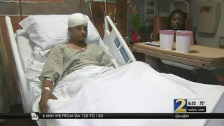 Man thrown from moving car trying to stop carjacker