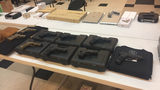 The guns, watches, phones recovered by authorities.