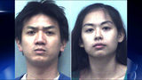 A former UPS worker and his girlfriend have been charged after several guns and phones were stolen.