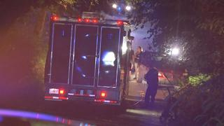 Man with multiple gunshot wounds found dead behind wheel of car