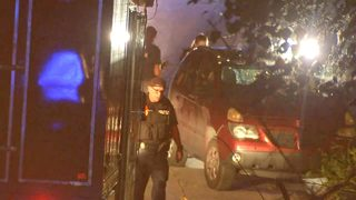 Officer finds man shot to death in idling car