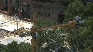 Crane hits powerlines in Cobb County, 1 injured