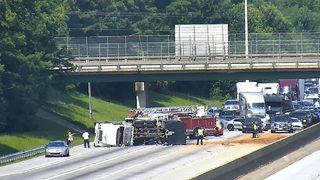 Overturned dump truck blocks I-85 for hours