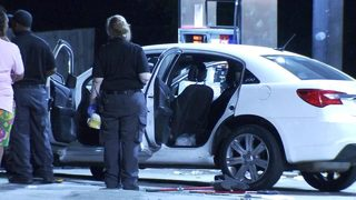 2 men shot in drive-by, another gets pinned under car dodging bullets