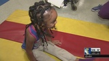5-year-old girl graduates from rehab program after being shot