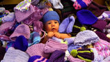 Baby with purple hats.